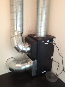 A wine cooler unit with ducts